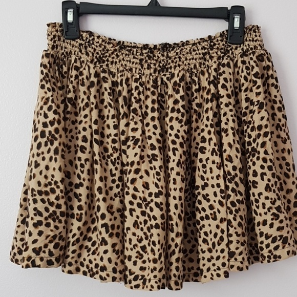 H&M Dresses & Skirts - H&M US size 12 Leopard print mini swing skirt